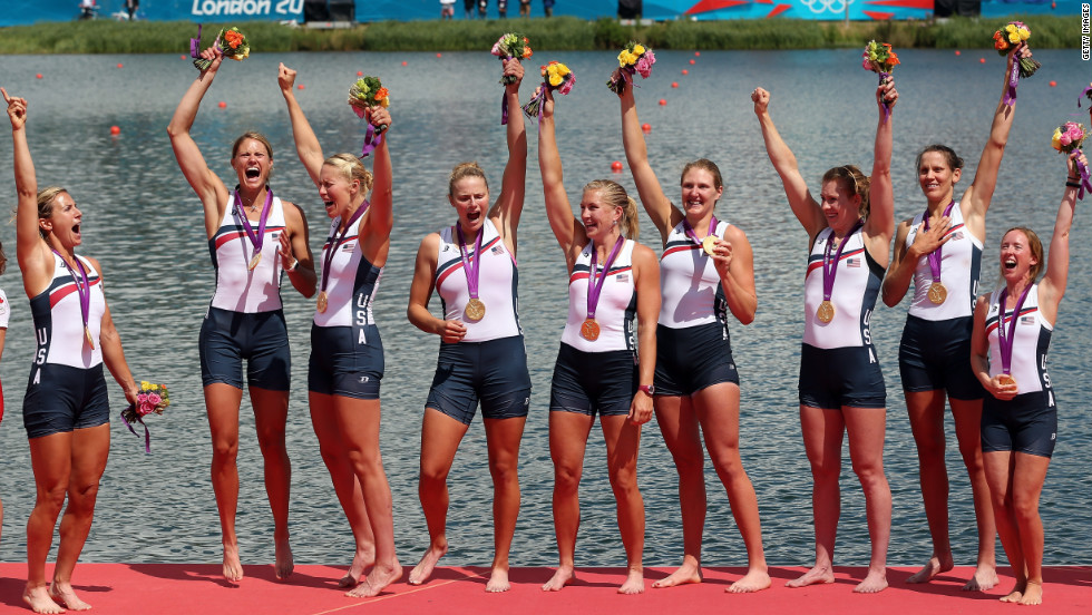 Members of the U.S. rowing team celebrate with their gold medals during the medal ceremony after the women's eight final at Eton Dorney in Windsor, England.