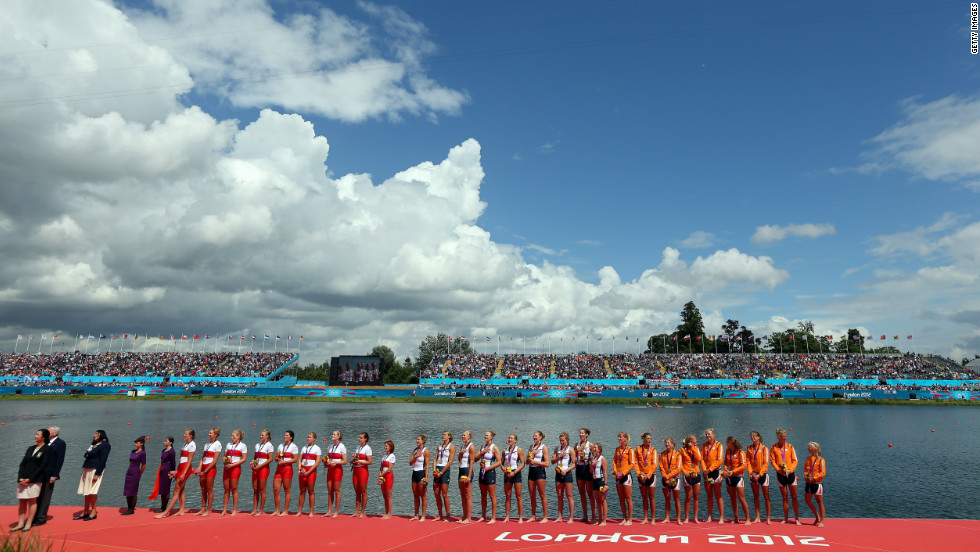 Members of the gold medal-winning U.S. team, the silver medal-winning Canadian team and the bronze medal-winning Dutch team line up during the medal ceremony.