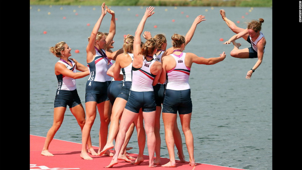 The U.S. team throws their cox Mary Whipple into the water after their big win.