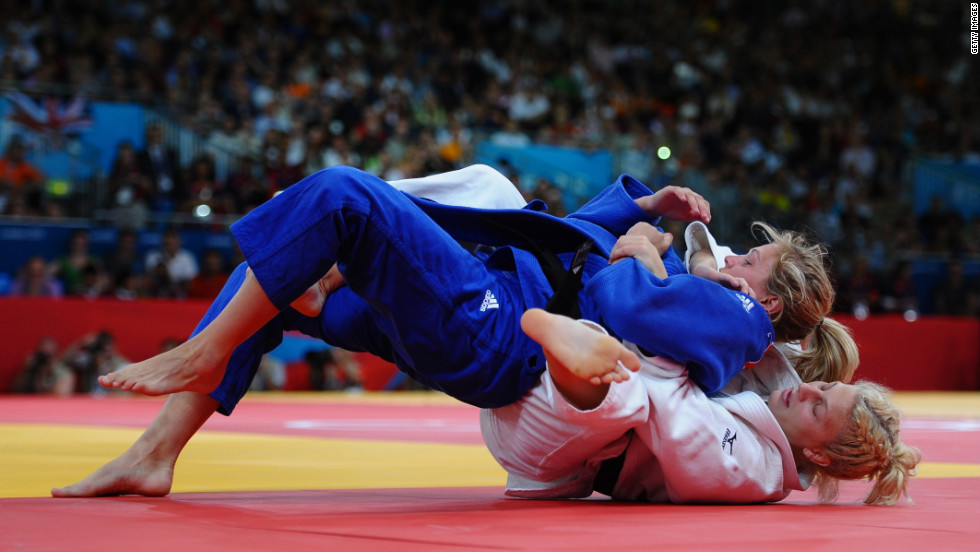 Kayla Harrison, in white, and Britain's Gemma Gibbons fight for first place.