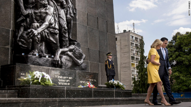 Mitt Romney and his wife, Ann, after a visit Tuesday to the Monument to the Ghetto Heroes in Warsaw, Poland.