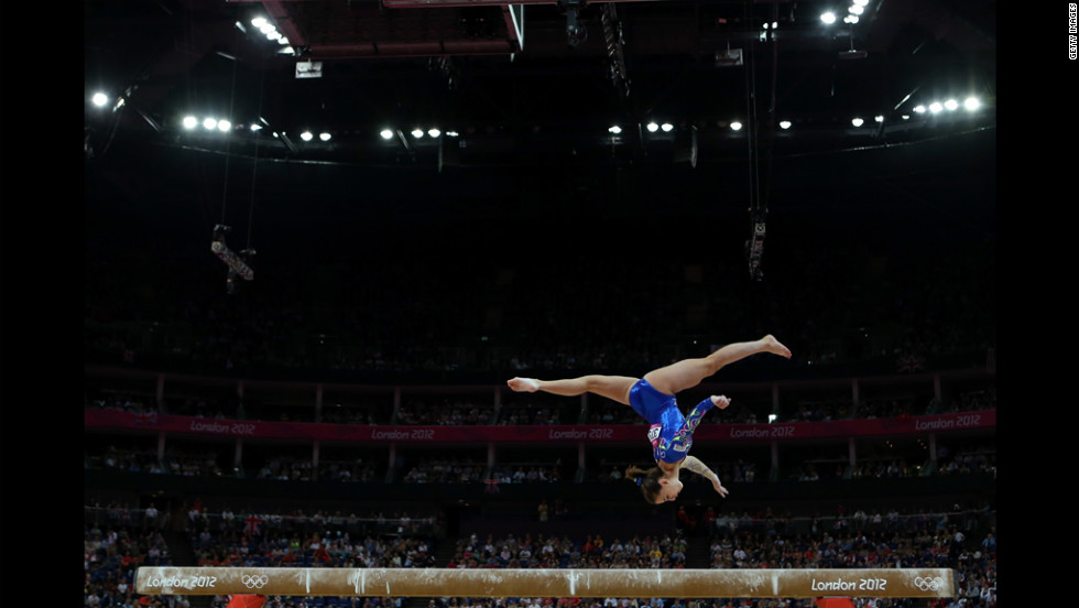 Italy's Carlotta Ferlito competes on the balance beam in the artistic gymnastics women's individual all-around final.