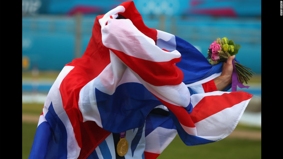 Gold medalist Etienne Stott gets lost in his flag, leading to more British embarrassment.