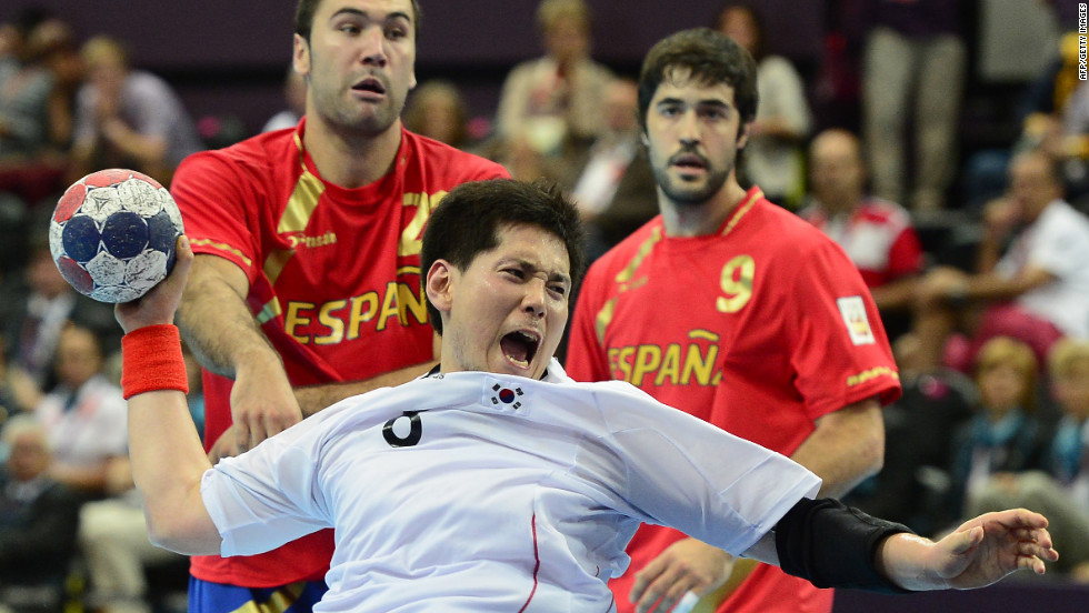 South Korea's Junggeu Park jumps to shoot during a men's preliminary handball match against Spain.