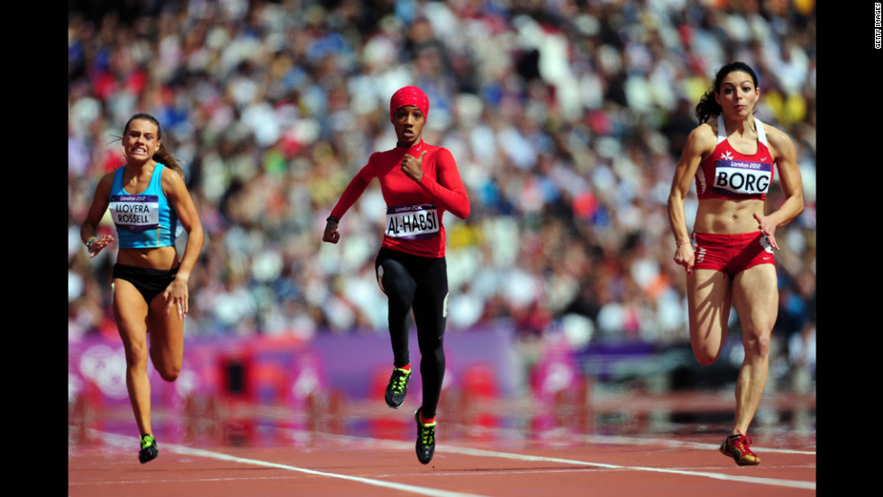 From left, Cristina Llovera of Andorra, Shinoona Salah Al-Habsi of Oman and Diane Borg of Malta compete in the women's 100-meter heats.