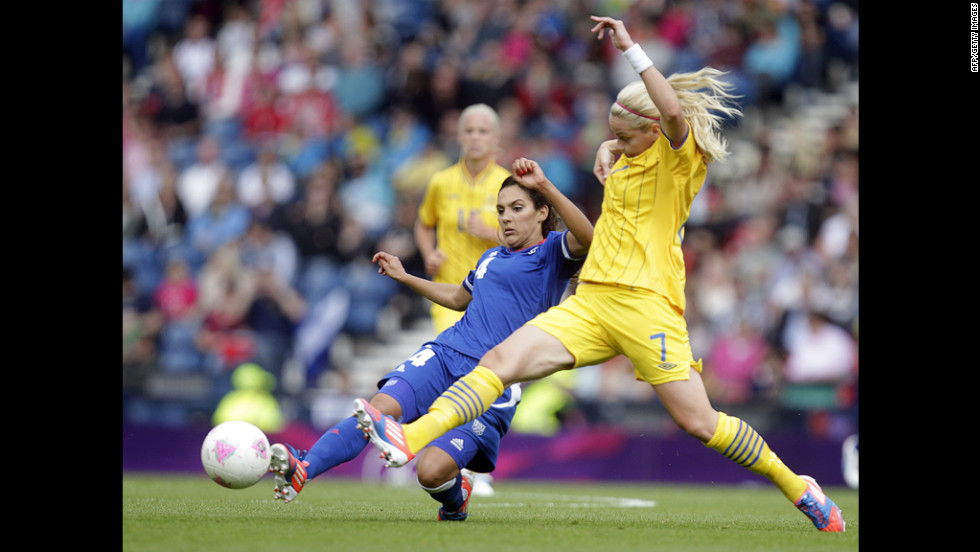 Sweden's Lisa Dahlkvist, right, vies with France's Louisa Necib during a women's football match at Hampden Park in Glasgow, Scotland.