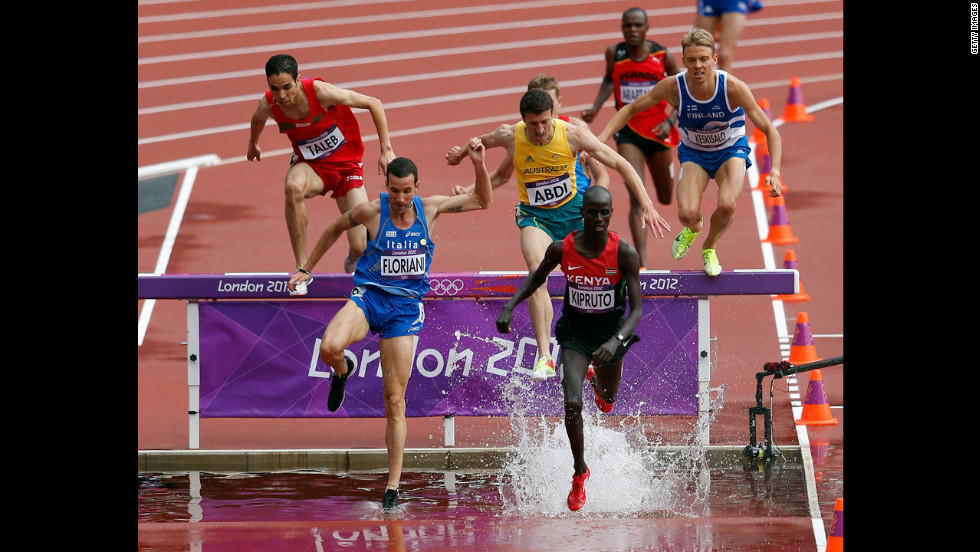 Italy's Yuri Floriani, left, and Kenya's Brimin Kiprop Kipruto compete in the men's 3,000-meter steeplechase.