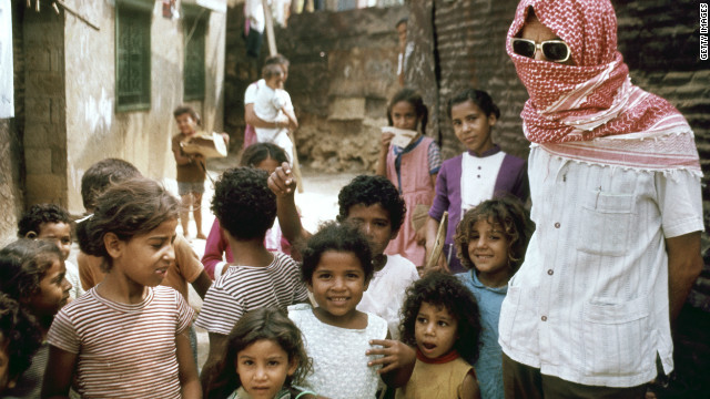 Palestinian refugees pose to be photographed in a Beirut refugee camp in 1973.