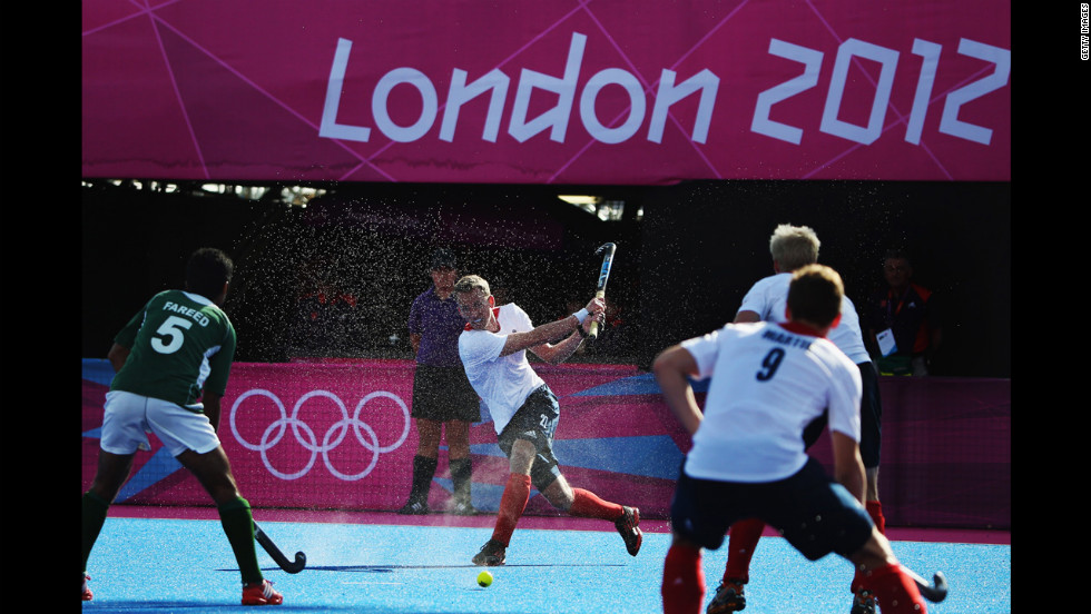Britain's James Tindall, center, makes a move during the men's field hockey match between Britain and Pakistan.