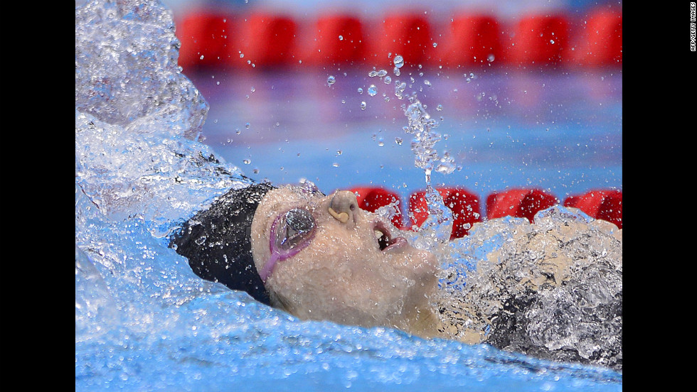 Missy Franklin competes in the women's 200-meter backstroke final. Franklin took gold in the event and American Elizabeth Beisel took bronze.