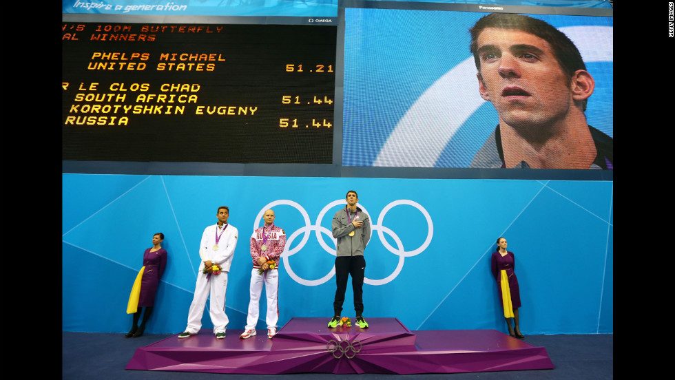 Left to right: Silver medalists Chad le Clos of South Africa and Evgeny Korotyshkin of Russia and gold medalist Michael Phelps listen to the United States national anthem during the medal ceremony for the men's 100-meter butterfly final on Friday, August 3.