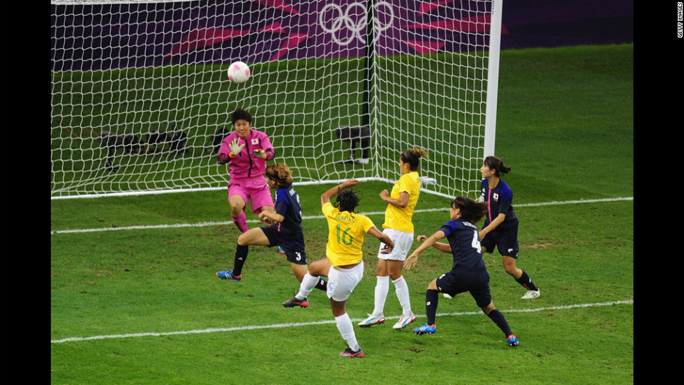 Renata Costa of Brazil blasts a shot over the bar as goalkeeper Miho Fukumoto of Japan looks on during the women's football quarter final match between Brazil and Japan on Friday.