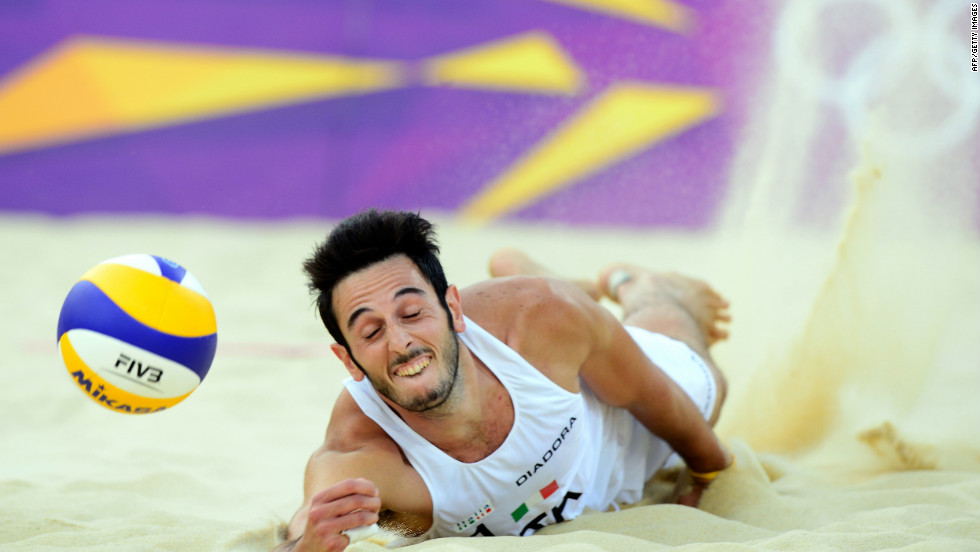 Italy's Paolo Nicolai dives for the ball during the men's beach volleyball match against Todd Rogers and Phil Dalhausser from the United States on Friday.