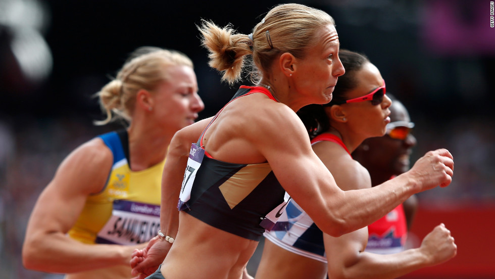 Jennifer Oeser of Germany competes in the women's heptathlon 100-meter hurdles heat.