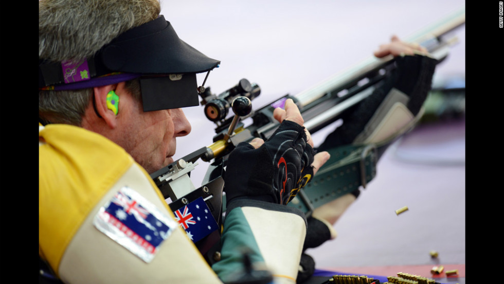 Warren Potent of Australia competes in the men's 50-meter rifle prone shooting qualification.