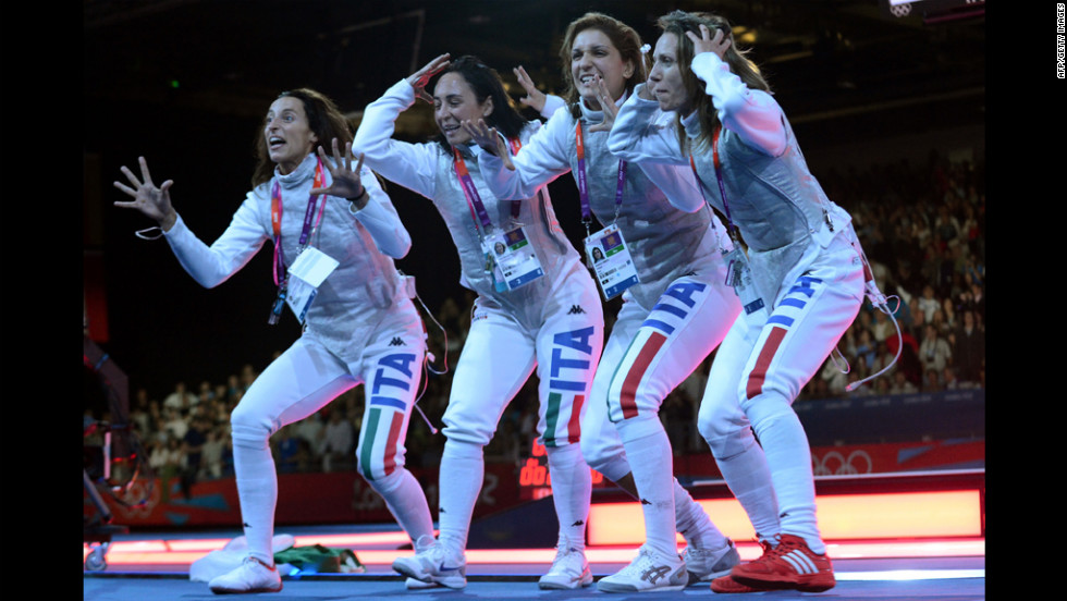 Left to right: Italy's Elisa Di Francisca, Arianna Errigo, Ilaria Salvatori and Valentina Vezzali celebrate winning gold during the women's foil final as part of the fencing event.