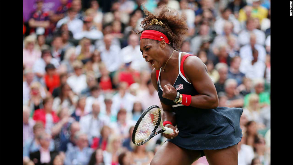 Serena Williams reacts to winning the gold medal in the women's singles tennis event.