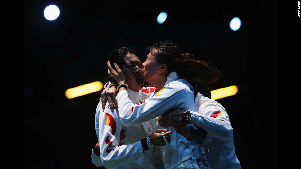 Sun Yujie and Xu Anqi of China celebrate after China beat Russia in the women's epee team fencing semifinal.
