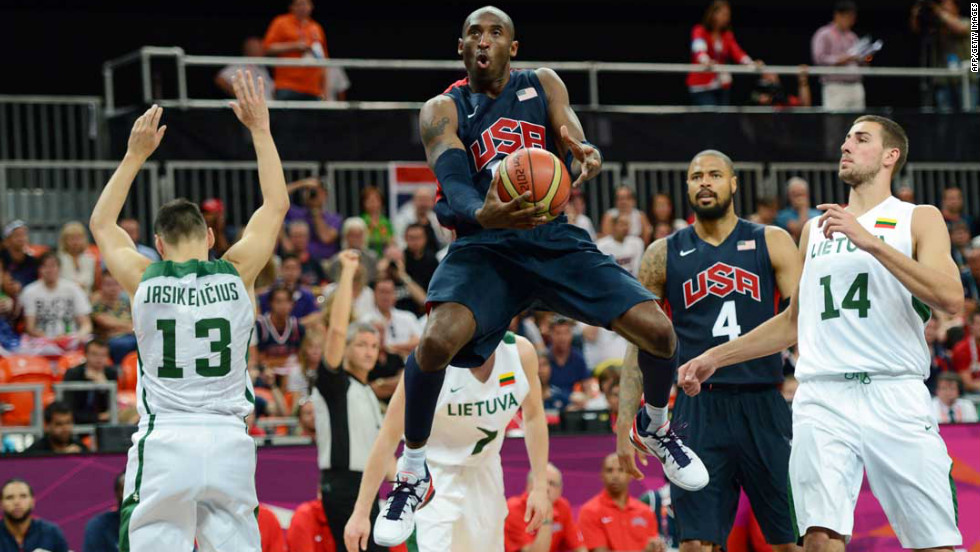 The United States' Kobe Bryant jumps with the ball during a men's preliminary round group A basketball match against Lithuania.