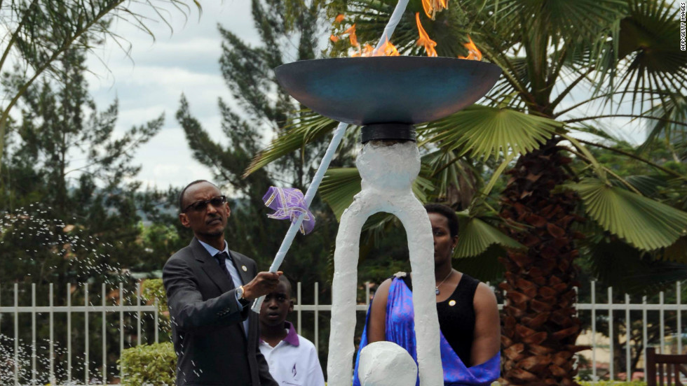 Rwandan President Paul Kagame lights a flame of remembrance to commemorate the genocide, which claimed approximately 800,000 lives in the span of 100 days -- including six of Niyonshuti's brothers and 60 of his extended family.