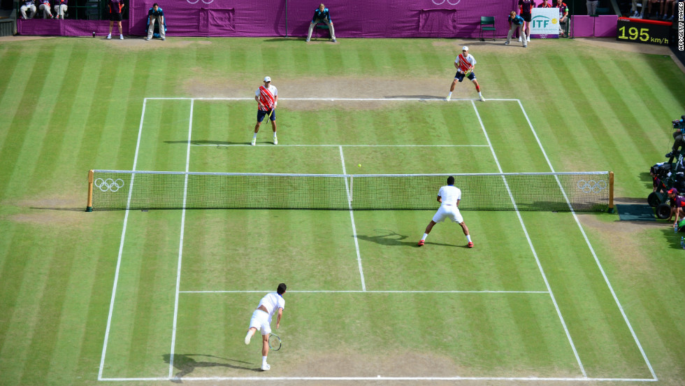 France's Michael Llodra and Jo-Wilfried Tsonga compete against Mike Bryan and Bob Bryan of the United States in the men's doubles final.