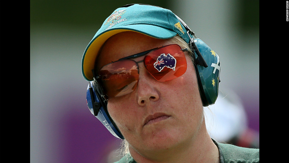 Australia's Corey Cogdell, sporting the map of her country on her glasses, competes in the women's trap shooting final.