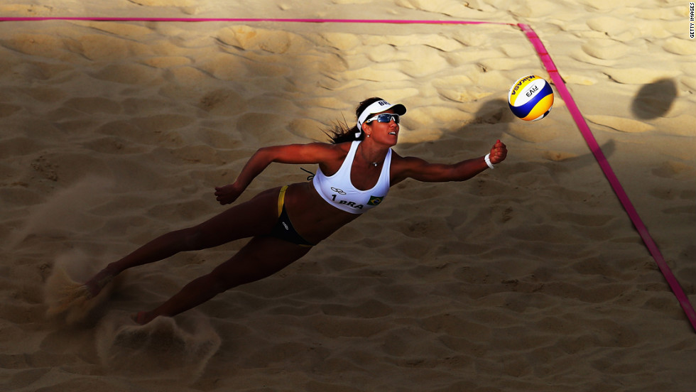 Maria Antonelli of Brazil dives for the ball during a women's beach volleyball round-of-16 match between Brazil and the Czech Republic.