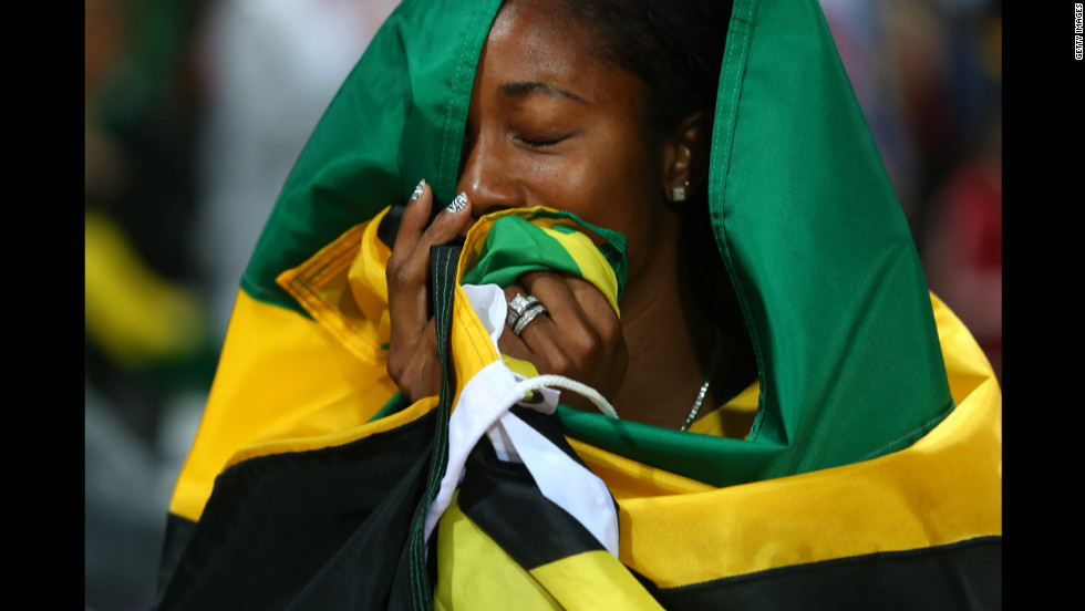 "Shelly-Ann Fraser-Pryce of Jamaica celebrates winning the gold in the women's 100-meter final on Saturday, August 4. Check out <a href=""http://www.cnn.com/2012/08/03/worldsport/gallery/olympics-day-seven/index.html"" target=""_blank"">Day 7 of competition</a> from Friday, August 3. The Games ran through August 12."