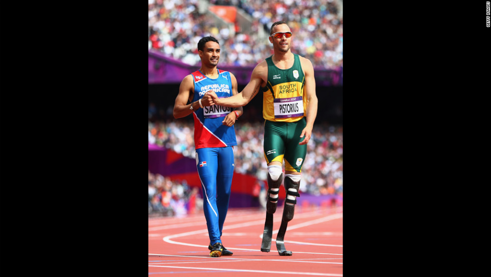 Luguelin Santos, left, of the Dominican Republic shakes hands with Oscar Pistorius of South Africa after competing in the preliminary heat of the men's 400-meter on Saturday.