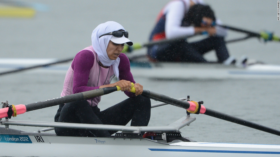 Iran's Soulmaz Abbasiazad rests after competing in the women's single sculls final of the rowing event Saturday.