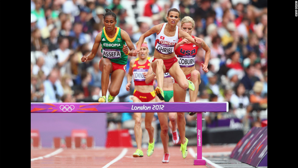 Sofia Assefa of Ethiopia, left, Habiba Ghribi of Tunisia and Emma Coburn of the United States compete in the women's 3,000-meter steeplechase.