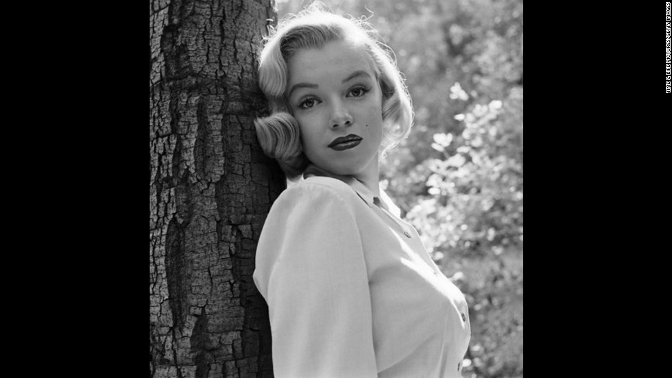 "Marilyn Monroe, then 24, is photograhed in Los Angeles' Griffith Park in 1950. Sunday, August 5, marked the 50th anniversary of Monroe's death at age 36. See more from this series on <a href=""http://life.time.com/icons/marilyn-monroe-early-photos-los-angeles-1950"" target=""_blank"">LIFE.com</a>."