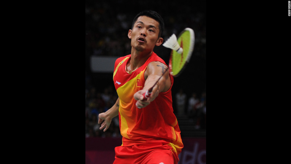 Lin Dan of China strikes the shuttlecock on his way to winning the men's singles gold medal against Chong Wei Lee of Malaysia.