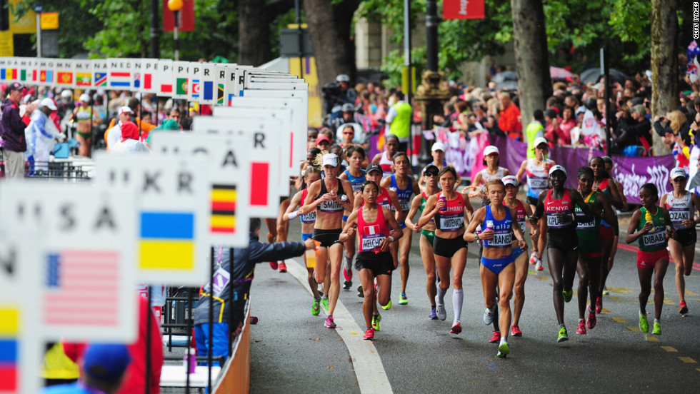 Runners make their way through London during the women's marathon.