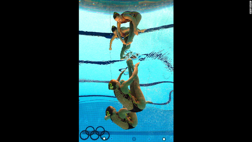 Mary Killman and Mariya Koroleva of the United States compete in the women's duets synchronized swimming technical routine.