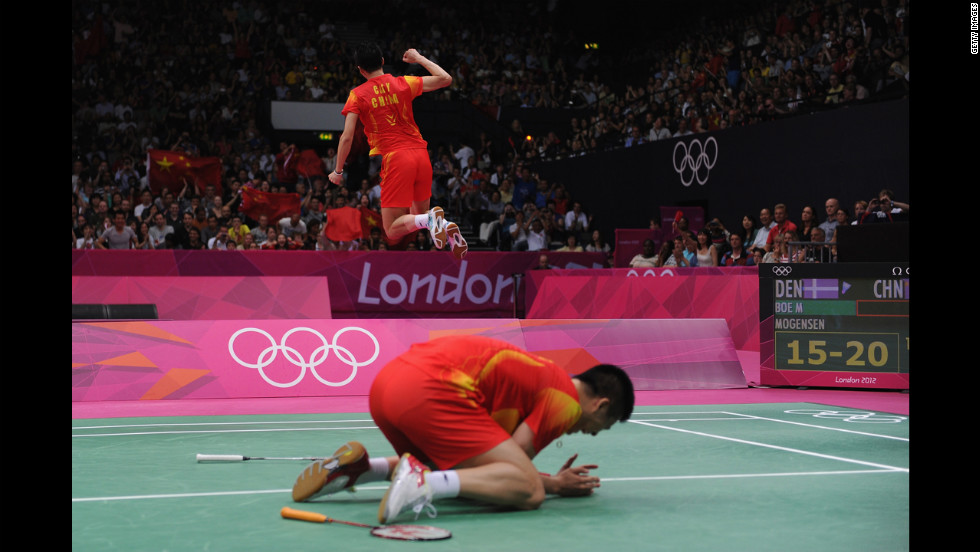 Yun Cai and Haifeng Fu of China revel in their victory against Mathias Boe and Carsten Mogensen of Denmark in the men's doubles badminton gold medal match.