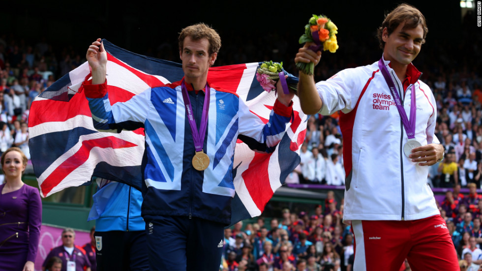 Gold medalist Andy Murray of Great Britain and silver medalist Roger Federer of Switzerland acknowledge the fans during the medal ceremony for the men's singles tennis match. Murray defeated Federer in straight sets, 2-6, 1-6, 4-6.