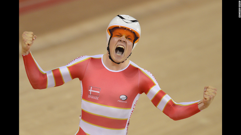Denmark's Lasse Norman Hansen experiences the thrill of victory after winning the gold medal in the men's omnium 1 kilometer time trial cycling event.