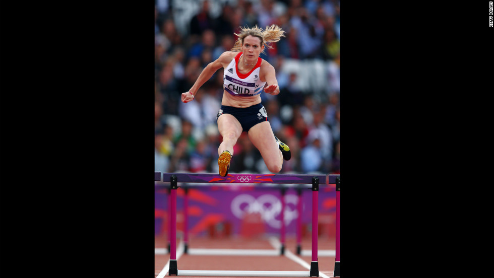 Eilidh Child of Great Britain clears a hurdle in the women's 400-meter hurdles round 1 heat.