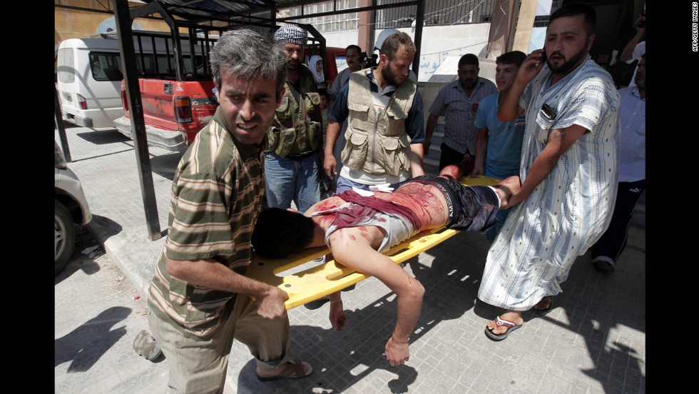 Syrians evacuate a civilian wounded in shelling in the northern city of Aleppo on Saturday, August 4. Syria's armed forces pounded Aleppo's rebel-held Salah ad-Din district with air and ground fire as violence also raged in the Shaar and Sukkari districts, according to reporters in the area and a rebel commander.