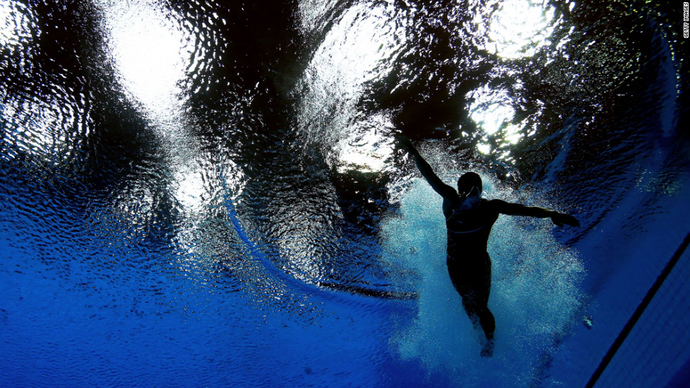 Cassidy Krug of the United States swims after her dive in the women's 3-meter springboard diving final.