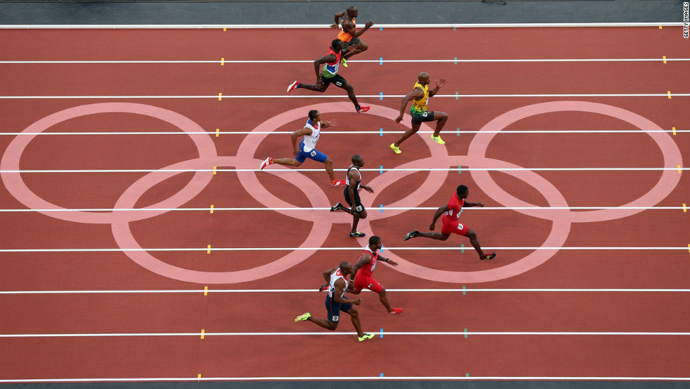 Asafa Powell of Jamaica and Justin Gatlin of the United States lead the pack in the men's 100-meter semifinal.