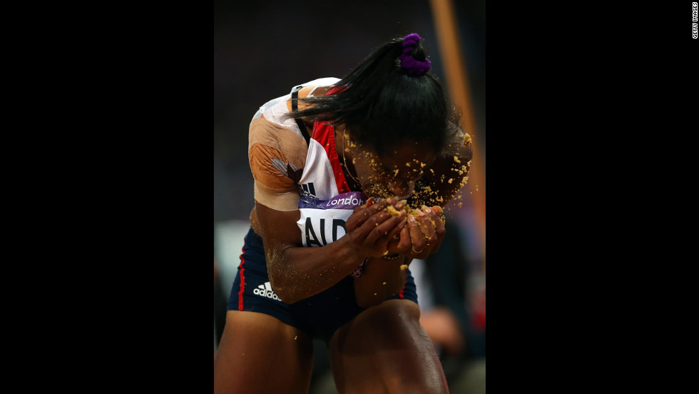 Yamile Aldama of Great Britain reacts after completing her jump in the women's triple jump final.
