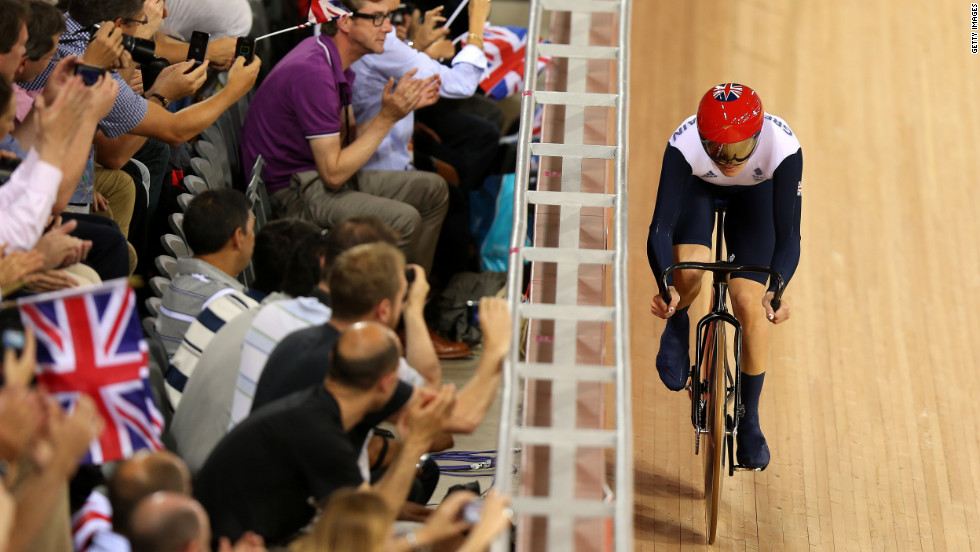 Spectators cheer on Victoria Pendleton of Great Britain during a women's sprint track cycling qualifier.