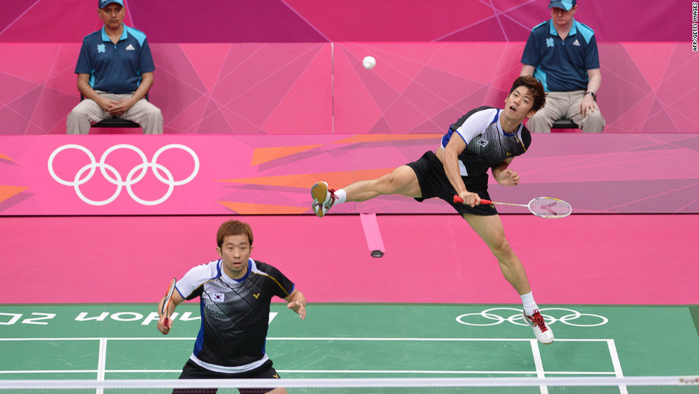 South Korea's Lee Yong Dae, right, plays a return next to his partner, Chung Jae Sung, in the bronze medal men's doubles badminton match against Koo Kien Keat and Tan Boon Heong of Malaysia.