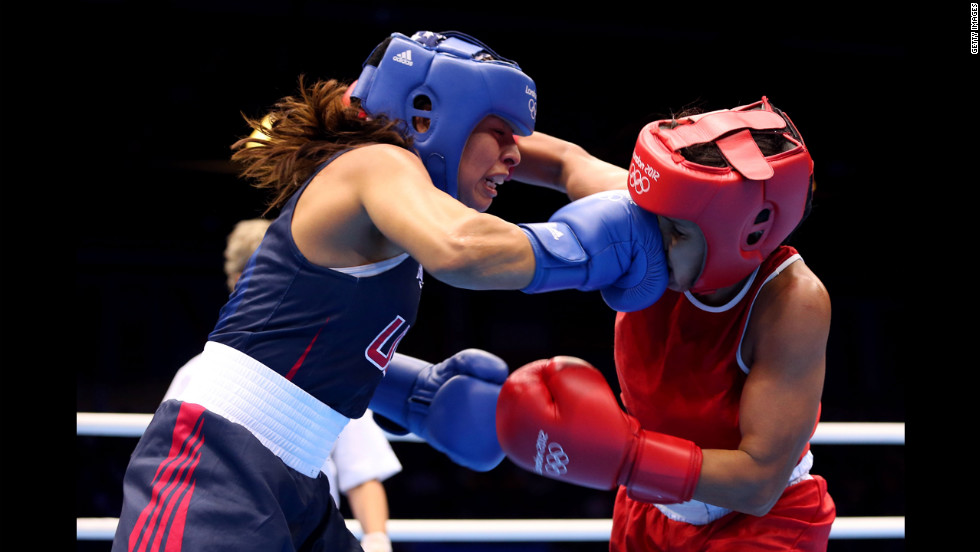 Marlen Esparza, left, of the United States connects with Karlha Magliocco of Venezuela during the women's fly (51-kilogram) boxing quarterfinals.