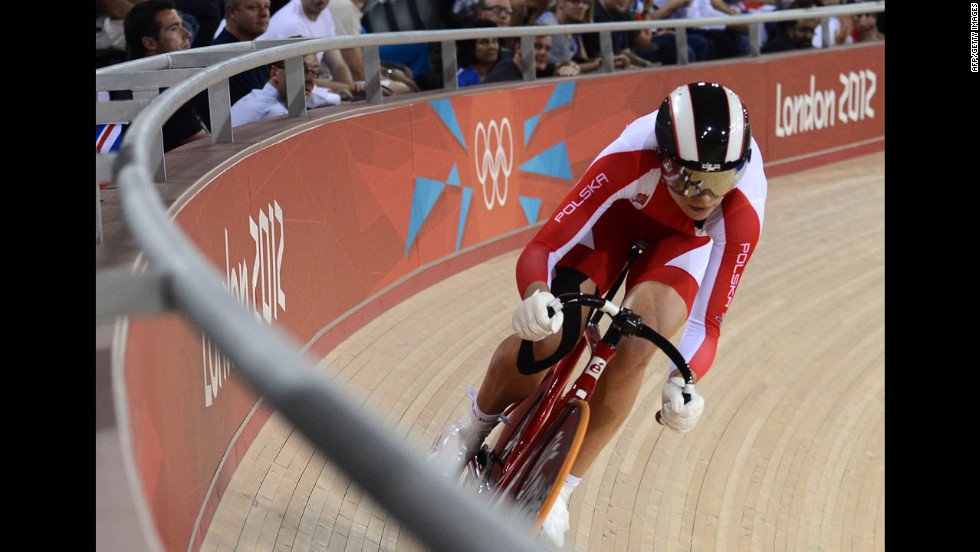 Poland's Malgorzata Wojtyra competes during the women's omnium flying lap 250-meter time trial cycling event.
