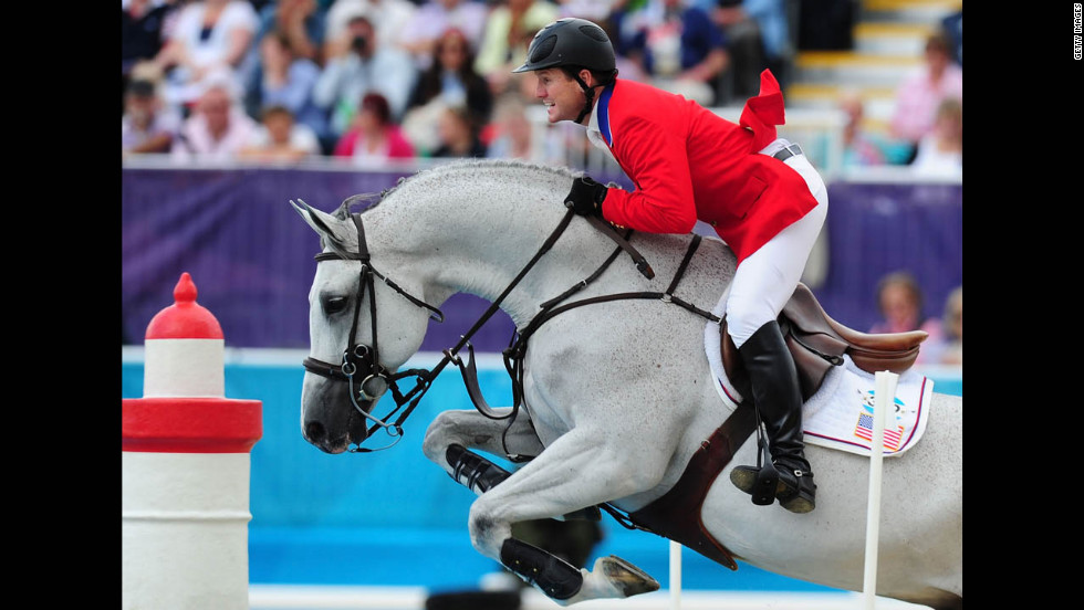 McLain Ward of the United States, riding Antares, competes in the third qualifier of individual jumping.