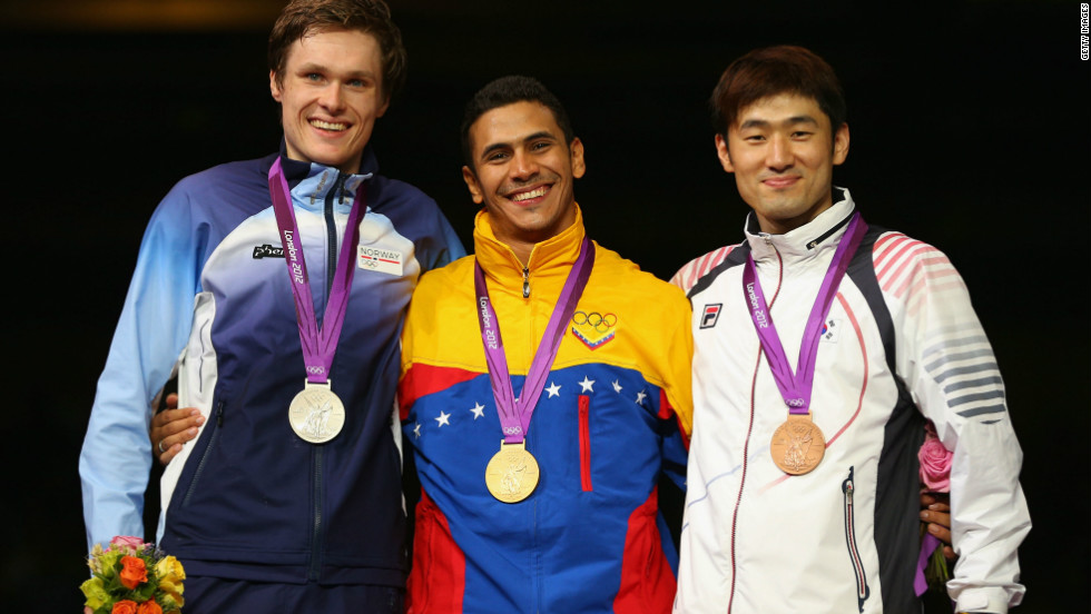 (L-R) Silver medalist Bartosz Piasecki of Norway, gold medalist Ruben Limardo Gascon of Venezuela and Jinsun Jung of Korea pose  during the medal ceremony for the Men's Epee Individual Fencing on August 1.