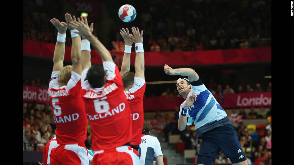 Steven Larsson of Great Britain jumps to shoot during the men's handball preliminaries Group A match against Iceland.